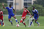 13 January 2015: Jose Ribas (Creighton) (ECU) (center) challenges Markhus Duke Lacroix (Penn) (left) for the ball as Dominique Badji (Boston University) (SEN) (right) follows the play. The 2015 MLS Player Combine was held on the cricket oval at Central Broward Regional Park in Lauderhill, Florida.
