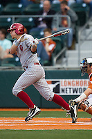 Oklahoma Sooners designated hitter Kolbey Carpenter #23 follows through on his swing against theTexas Longhorns in the NCAA baseball game on April 5, 2013 at UFCU DischFalk Field in Austin Texas. Oklahoma defeated Texas 2-1. (Andrew Woolley/Four Seam Images).
