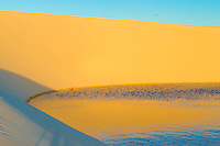 Rainwater  ponds trapped in  dunes at sunset, Lencois Maranhenses National Park, Brazil, Atlantic Ocean