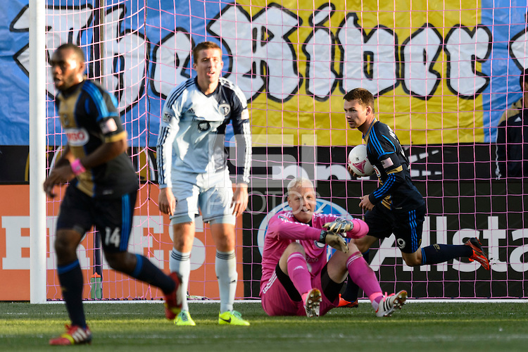 Jack McInerney (9) of the Philadelphia Union celebrates scoring on Sporting Kansas City goalkeeper Jimmy Nielsen (1). Sporting Kansas City defeated the Philadelphia Union 2-1 during a Major League Soccer (MLS) match at PPL Park in Chester, PA, on October 26, 2013.