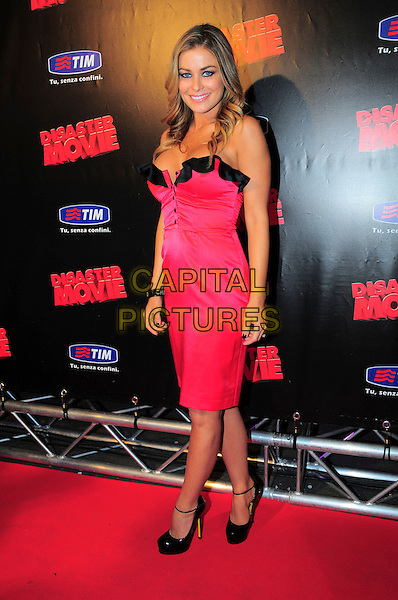 "CARMEN ELECTRA .Italian Film Premiere for ""Disaster Movie"" in Rome, Italy, October 8th 2008..full length pink dress black shoes ankle strap trim ruffle buttons strapless .CAP/CAV.©Luca Cavallari/Capital Pictures"