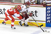 Lauren Cherewyk (BU - 7), Caitlin Walsh (BC - 11) - The Boston College Eagles defeated the Boston University Terriers 2-1 in the opening round of the Beanpot on Tuesday, February 8, 2011, at Conte Forum in Chestnut Hill, Massachusetts.