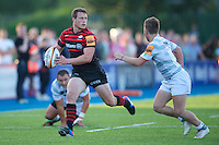 20130803 Copyright onEdition 2013 ©<br /> Free for editorial use image, please credit: onEdition.<br /> <br /> Jack Wilson of Saracens 7s looks to offload during the J.P. Morgan Asset Management Premiership Rugby 7s Series.<br /> <br /> The J.P. Morgan Asset Management Premiership Rugby 7s Series kicks off for the fourth season on Thursday 1st August with Pool A at Kingsholm, Gloucester with Pool B being played at Franklin's Gardens, Northampton on Friday 2nd August, Pool C at Allianz Park, Saracens home ground, on Saturday 3rd August and the Final being played at The Recreation Ground, Bath on Friday 9th August. The innovative tournament, which involves all 12 Premiership Rugby clubs, offers a fantastic platform for some of the country's finest young athletes to be exposed to the excitement, pressures and skills required to compete at an elite level.<br /> <br /> The 12 Premiership Rugby clubs are divided into three groups for the tournament, with the winner and runner up of each regional event going through to the Final. There are six games each evening, with each match consisting of two 7 minute halves with a 2 minute break at half time.<br /> <br /> For additional images please go to: http://www.w-w-i.com/jp_morgan_premiership_sevens/<br /> <br /> For press contacts contact: Beth Begg at brandRapport on D: +44 (0)20 7932 5813 M: +44 (0)7900 88231 E: BBegg@brand-rapport.com<br /> <br /> If you require a higher resolution image or you have any other onEdition photographic enquiries, please contact onEdition on 0845 900 2 900 or email info@onEdition.com<br /> This image is copyright the onEdition 2013©.<br /> <br /> This image has been supplied by onEdition and must be credited onEdition. The author is asserting his full Moral rights in relation to the publication of this image. Rights for onward transmission of any image or file is not granted or implied. Changing or deleting Copyright information is illegal as specified in the Copyright, Design and Patents Act 19