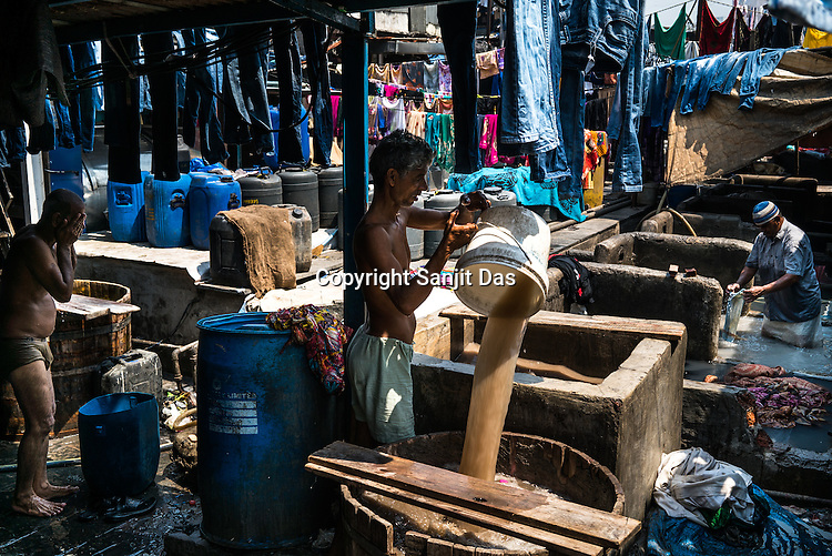 A washerman bathes while others carry on with the washing of clothes at the open-air Laundromat in Dhobighat in India's financial capital, Mumbai, India. The laundry comes from different sections of the society - from hospital to hospitality to garment factories and normal households.