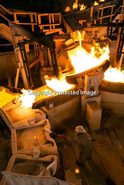 MUFULIRA, ZAMBIA- JULY 6: A employee works at the copper smelter at Mopani Mines on July 6, 2016 in Mufulira, Zambia.The copper is trucked to ports such as Dar es Salaam, Tanzania & Durban, South Africa. Glencore, an Anglo-Swiss multinational commodity trading and mining company, owns about 73 % of Mopani mines, which produces copper and some cobalt. The mine employs about 15,000 people.  Many people in the area dependent of the mines and its subcontractors for work. (Photo by Per-Anders Pettersson)