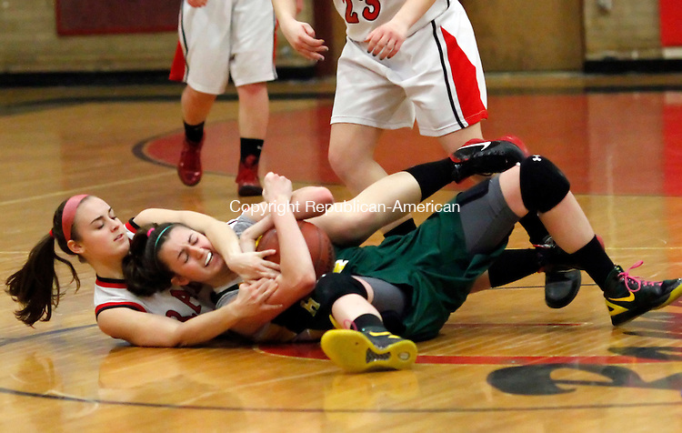 Cheshire, CT-16 February 2012-021612CM17-  Cheshire's Maria Blois (left) and Hamden's Sarah Shields battle for the ball during the first round of the SCC tournament in Cheshire Thursday night. Cheshire edged out Hamden 57-55.  Christopher Massa Republican-American