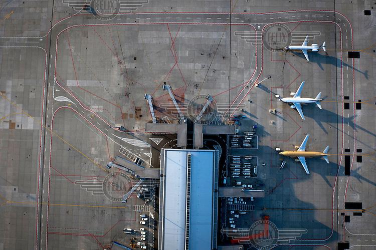 An aerial view of aeroplanes waiting at gates at Warsaw Chopin Airport.