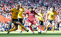Liverpool's Mohamed Salah has his effort charged down by Wolverhampton Wanderers' Ryan Bennett<br /> <br /> Photographer Rich Linley/CameraSport<br /> <br /> The Premier League - Liverpool v Wolverhampton Wanderers - Sunday 12th May 2019 - Anfield - Liverpool<br /> <br /> World Copyright © 2019 CameraSport. All rights reserved. 43 Linden Ave. Countesthorpe. Leicester. England. LE8 5PG - Tel: +44 (0) 116 277 4147 - admin@camerasport.com - www.camerasport.com