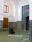 Woman praying at Kusam ibn Abbas mausoleum, Shahi Zinda Necropolis, Samarkand
