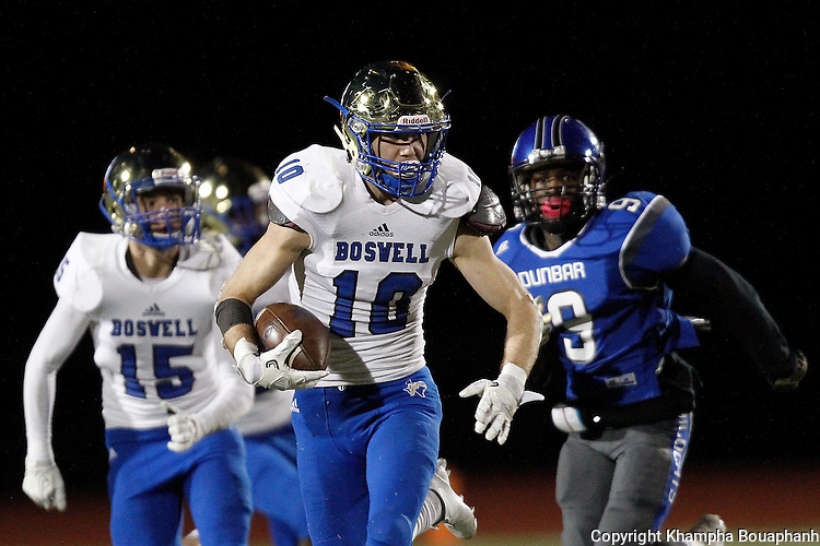 Boswell senior defensive back Jacob Mueller returns an interception during their 30-12 win over Dunbar in 5A high school football area playoff at Ranger Stadium in Fort Worth on Friday, November 18, 2016. The Pioneers had three interception and recovered 2 fumbles.