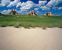 Cumulous cloud formations over buttes in the Badlands on the Castle Trail; Badlands National Park, SD