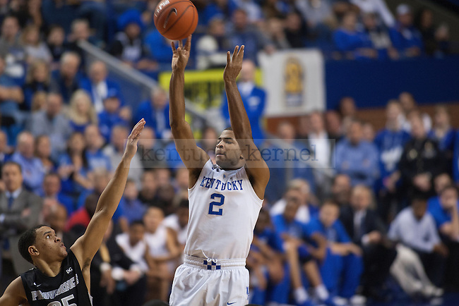 Guard Aaron Harrison of the Kentucky Wildcats shoots a three during the second half of the game against the Providence Friars at Rupp Arena on Sunday, November 30, 2014 in Lexington, Ky. Kentucky defeated Providence 58-38. Photo by Michael Reaves | Staff