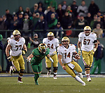 (Boston, MA, 11/21/15) Boston College quarterback John Fadule (14) carries the ball during the fourth quarter as Notre Dame hosts Boston College at Fenway Park in Boston on Saturday, November 21, 2015. Photo by Christopher Evans