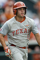 Texas Longhorns shortstop CJ Hinojosa (9) runs to first base during the NCAA baseball game against the Houston Cougars on June 6, 2014 at UFCU Disch–Falk Field in Austin, Texas. The Longhorns defeated the Cougars 4-2 in Game 1 of the NCAA Super Regional. (Andrew Woolley/Four Seam Images)