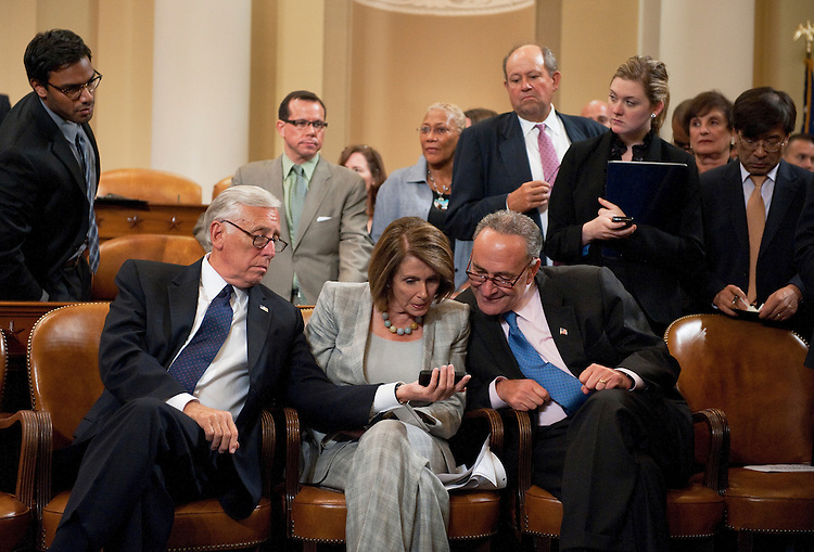 UNITED STATES - SEPTEMBER 22:  From left, House Minority Whip Steny Hoyer, D-Md., House Minority Leader Nancy Pelosi, D-Calif., Sen. Charles Schumer, D.N.Y., confer during a ceremony to unveil the portrait of Rep. Charlie Rangel, D-N.Y., in the House Ways and Means Committee hearing room in Longworth Building.  Rangel was chairman of the Committee from 2007-2010.  (Photo By Tom Williams/Roll Call)