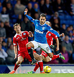 Harry Forrester skips past two QoS defenders