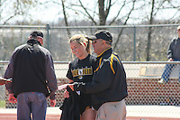 University of Misouri freshman Leslie Farmer gets a hug and a few words from Mizzou head coach Rick Mcguire after a race at the 2009 Jefferson Cup, a dual track meet between the University of Missouri and the University of Virginia, Saturday, April 4, 2009, in Columbia, Missouri.