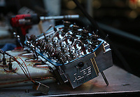 Aug. 3, 2014; Kent, WA, USA; Detailed view of the aluminum Alan Johnson Performance cylinder heads for the nitro powered engine of NHRA funny car driver Cruz Pedregon in the pits during the Northwest Nationals at Pacific Raceways. Mandatory Credit: Mark J. Rebilas-