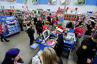 NWA Media/ J. T. WAMPLER-  Around fifty Springdale police officers took children shopping Friday Dec. 12, 2014 at the Pleasant St. Wal-Mart spending around $33,000. The funds came from donations, corporate spoonsorships and fund raisers.