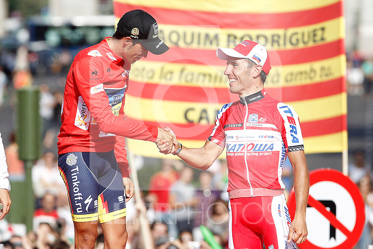 Alberto Contador, first classified  (l) and Joaquin Purito Rodriguez, third classified in the podium of of La Vuelta 2012.September 9,2012. (ALTERPHOTOS/Acero)