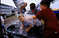 Silliness rises to an art form as the serious businesss of competitions and auctions winds down at the end of the Nobles County, Minnesota fair. Boys dump water on their friend.