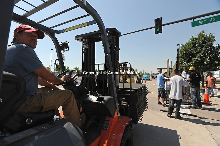 Workers secure a second perimeter around the Pepsi Center, site of the Democratic National Convention, in Denver, Colorado, on August 22, 2008, just three days before the convention gets underway.  With the arrival of 1,700 journalists, numerous delegates, Democratic Party officials and Democratic presidential candidate Barack Obama, security in Denver is tightening.