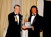 American actor, director, screenwriter, and producer Sylvester Stallone, right, accepts an award from former Washington Redskins head coach George Allen, left, at the Washington, DC Touchdown Club dinner in Washington, DC on January 23, 1988.  .<br /> Credit: Arnie Sachs / CNP