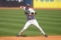 Shortstop Ryan Jackson #8 of the Miami Hurricanes makes a throw to first base at Durham Bulls Athletic Park May 21, 2009 in Durham, North Carolina.  (Photo by Brian Westerholt / Four Seam Images)