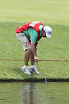 US Open 2011 Bethesda, MD. 17/6/11.Rory McIlroy (NIR) caddy fishing his ball from the water.on day two of the USGA US OPEN at Congressional country club, Bethesda, Washington..Picture Fran Caffrey/www.golffile.ie