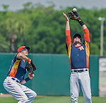 20 March 2015: Houston Astros infielder Jed Lowrie gets the out as Colby Rasmus looks on during Spring Training action against the Washington Nationals at Osceola County Stadium in Kissimmee, Florida. The Astros fell to the Nationals 7-5 in Grapefruit League play. Mandatory Credit: Ed Wolfstein Photo *** RAW (NEF) Image File Available ***