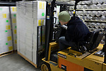 Josh Hicks of the USGS Rock Core, maneuvers a forklift of ice core samples into the storage facility at the National Ice Core Laboratory....National Ice Core Laboratory, Lakewood, Colo.  Photographs from inside the laboratory and its storage space.  Ice core samples are drilled and transported from ice sheets in Greenland and Anarctica and transportd to the Ice Core Lab for processing and distribution to laboratories that have received grants from the National Science Foundation.  Because the cores trap greenhouse gas and ash samples, climate scientists can extract data about the Earth's climate from upwards of 400,000 years ago.  Samples are packed in silver tubes, placed in insulated boxes, and shipped from the ice caps in refrigerated cargo containers; the storage space is kept at -36 degrees Farenheit.