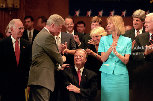 United States President Bill Clinton shakes hands with US Senator Max Cleland (Democrat of Georgia) prior to making remarks at an event in the Dirksen Senate Office Building on Capitol Hill to advocate for the passage of the &quot;Patient's Bill of Rights&quot; on Thursday, July 16, 1998.<br /> Credit: Ron Sachs / CNP
