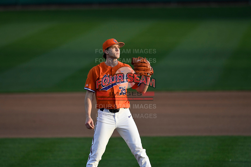 Relief pitcher Ryan Miller (35) of the Clemson Tigers waits for a throw in a game against the William and Mary Tribe on February 16, 2018, at Doug Kingsmore Stadium in Clemson, South Carolina. Clemson won, 5-4 in 10 innings. (Tom Priddy/Four Seam Images)