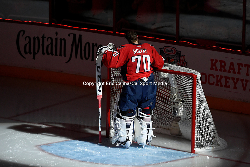 April 15, 2015 - Washington D.C., U.S. - Washington Capitals goalie Braden Holtby (70) prepares for game 1 of the  NHL Eastern Conference Quarter finals between the New York Islanders and the Washington Capitals held at the Verizon Center in Washington DC. The Islanders defeat the Capitals  4-1 in regulation time. Eric Canha/CSM