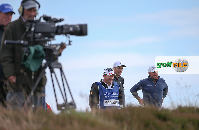 Ross Fisher (ENG) and Graeme McDowell (NIR) wait on the 16th green to allow those behind to play up during the First Round of the 2016 Aberdeen Asset Management Scottish Open, played at Castle Stuart Golf Club, Inverness, Scotland. 07/07/2016. Picture: David Lloyd | Golffile.<br /> <br /> All photos usage must carry mandatory copyright credit (&copy; Golffile | David Lloyd)