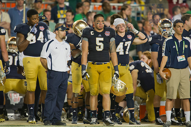 Jan. 7, 2013; Linebacker Manti Te'o watches the last minutes of the game against Alabama in the 2013 BCS National Championship in Miami, Florida. Alabama defeated Notre Dame 42 to 14. Photo by Barbara Johnston/University of Notre Dame