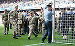 It's a goal...  the Armed Forces enjoying their day on the Ibrox pitch at half-time