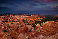 730750030 sunset light turns the silent city hoodoos a reddish gold during a clearing summer storm seen from sunset point in bryce canyon national park in south central utah
