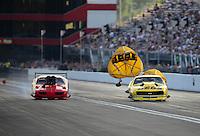 Jun. 15, 2012; Bristol, TN, USA: NHRA pro mod driver Troy Coughlin (right) pops his chutes alongside Peter Farber during qualifying for the Thunder Valley Nationals at Bristol Dragway. Mandatory Credit: Mark J. Rebilas-