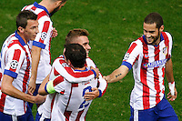 Atletico de Madrid´s Griezmann celebrates a goal with Diego Godin, Arda Turan  during Champions League soccer match between Atletico de Madrid and Malmo at Vicente Calderon stadium in Madrid, Spain. October 22, 2014. (ALTERPHOTOS/Victor Blanco)