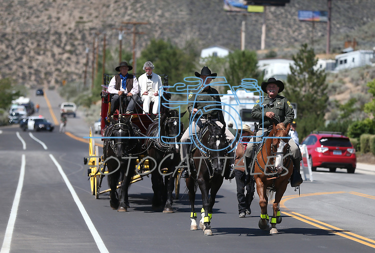 Diginitaries ride in on the Wells Fargo stagecoach for the ribbon-cutting ceremony at the NV150 Fair at Fuji Park, in Carson City, Nev., on Thursday, July 31, 2014.<br /> Photo by Cathleen Allison