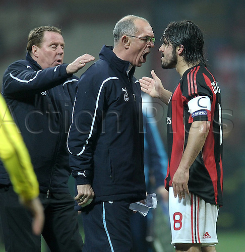 15.02.2011 Champions League AC Millan v Tottenham Hotspur. San Siro. AC Milan midfielder Gennaro Gattuso appeared to be in the mood for a scrap the moment the referee blew the first whistle. He is pictured here attacking the 59 year old Tottenham assistant Joe Jordan with Haryy Redknapp in the background.