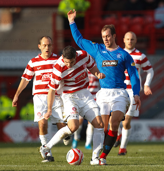Steven Whittaker surrounded by Hamilton players as he tries to make a break from David Elebert