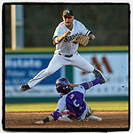 Second baseman Andres Kim (2) of the University of South Carolina Upstate Spartans flies over Trent Harris of the High Point Panthers as he makes the put out on Friday, March 22, 2019, at Cleveland S. Harley Park in Spartanburg, South Carolina. High Point won, 4-2. (Tom Priddy/Four Seam Images)