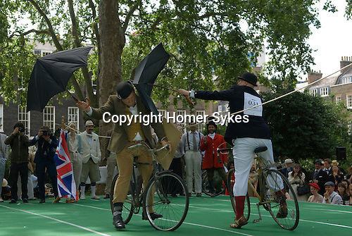 The Chap Olympiad Bedford Square London UK. Umbrella Jousting competition.