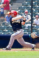 Derek Norris #25 of the Harrisburg Senators follows through on his swing against the Richmond Flying Squirrels at The Diamond on July 22, 2011 in Richmond, Virginia.  The Squirrels defeated the Senators 5-1.   (Brian Westerholt / Four Seam Images)