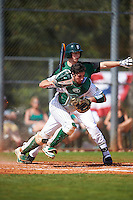 Eastern Michigan Eagles catcher Robert Iacobelli (49) retrieves a blocked pitch in the dirt as batter Matthew Beaton (19) waves the runner to go during a game against the Dartmouth Big Green on February 25, 2017 at North Charlotte Regional Park in Port Charlotte, Florida.  Dartmouth defeated Eastern Michigan 8-4.  (Mike Janes/Four Seam Images)