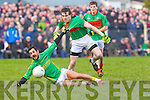 Paul Galvin of Finuge battles with Beal's Colm Kissane in the Bernard O'Callaghan Memorial Senior Football Championship Final last Sunday in Ballylongford.