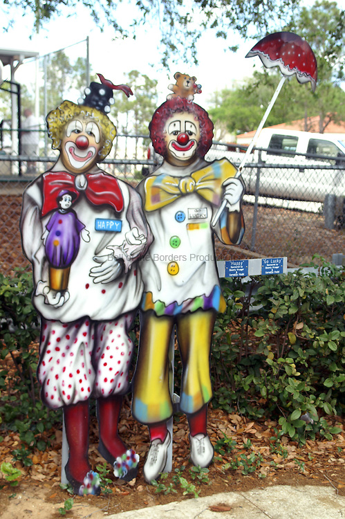 Free standing painting of Happy and Go Lucky in front of the elementary school in Lake Placid