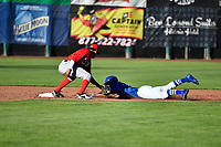 Brayan Morales (8) of the Ogden Raptors dives to second base while Franklin Torres (6) of the Orem Owlz makes the tag in Pioneer League action at Lindquist Field on June 22, 2017 in Ogden, Utah. The Owlz defeated the Raptors 13-8.  (Stephen Smith/Four Seam Images)